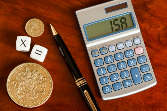 isa-written-on-calculator-screen-with-pound-coins-and-pen